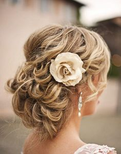 1. A beautiful way to keep your hair out of your face without going too polished. We love that her natural curl created this perfectly messy chignon look. See more of this San Juan Capistrano wedding here captured by Heidi Ryder Photography.
