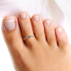 Sterling silver adjustable flower toe ring. This dainty ring may also be used as…