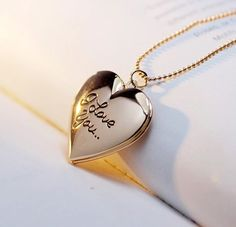 """- Keepsake Necklace Heart Engraved"""" I Love You"""" Holds 2 Photos Inside Gender:Women - Style: Classic Romantic Metals Type:Gold Plated, Silver Plated Chain Type:Popcorn Chain - Necklace Type: Heart Shap"""