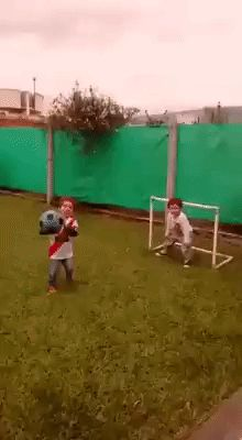 Child reaction. Two kids playing football