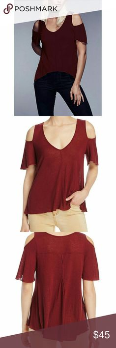 Free People Cut Out Shoulders Tee This Free People Bittersweet Tee features an effortless oversized fit thats semi-sheer and lightweight.   Wine color Short sleeves V-neckline Cut-out shoulders Loose fit Hi-low hem Ruffle trim Sizing Tip: Style runs small make sure to size up 70% Rayon, 30% Linen Free People Tops Blouses