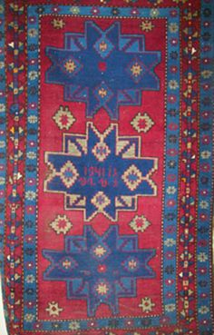 """4'0"""" x 6'9"""" Antique 1941 Hand woven Armenian Rug.   Inscription in the center medallion reads """"1941"""" and also includes the initials of the person who made the rug """"SNS"""".  Has three medallions.  Red crimson background with blue and navy blue designs.  Handwoven in Yerevan, Armenia (Old Russia)."""