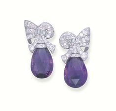 A PAIR OF DIAMOND AND AMETHYST EAR PENDANTS   Each designed as a briolette amethyst to the brilliant and baguette-cut diamond scroll top, mounted in platinum, 4.4 cm. long