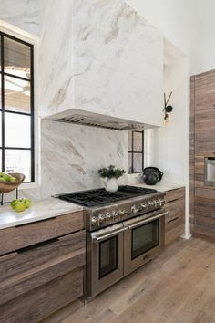 Gorgeous stone hood with rustic modern cabinetry