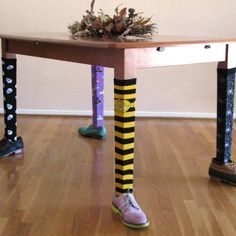 Best-Dressed Table Legs - Just posted this in Halloween DIY, but can you imagine something similar with lace stockings, button boots, and a ruffled (hoop skirt look) tablecloth? Maybe hike the tablecloth like a burlesque skirt to show off the legs.