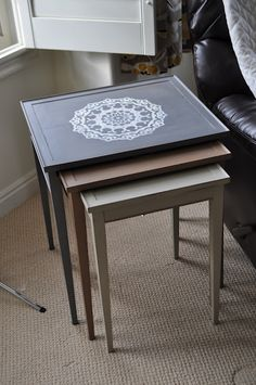 Painted Doily Nesting Tables. Nesting tables are a set of usually either 2 or 3 tables of the same design but of decreasing scale, making it possible for the smaller tables to nest within the large ones. These tables are great for small spaces because they can be divided when more function is necessary, and nested when not in use.