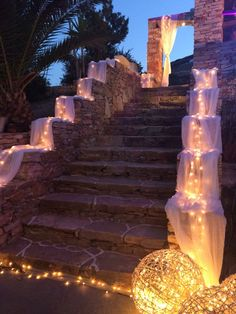 Wedding in Sifnos. Beautiful decoration with lots of lights and linen. Plan your wedding in Greece.