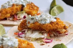 "Taco made with coleslaw, super crispy breaded cauliflower ""steaks"" and tartar sauce."