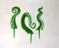 Package of 12 toppers 4 of each design Each tentacle measures 2 tall (50mm) (without the pick)  If you like one design in particular and want a whole pack of them, or if you would like them larger for an awesome kraken cake diorama, message me about setting up a custom order. Acrylic is shatter resistant, durable and cleanable. These pieces are completely reusable.  Shown in green these also come in purple. Want a different color?…