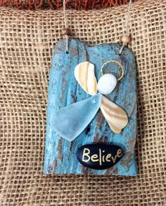 A personal favorite from my Etsy shop https://www.etsy.com/listing/523865347/beachcomber-believe-angel