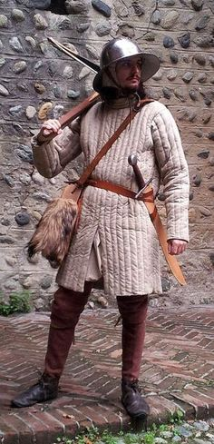 Piedmont crossbowman from the half of XIII century. He's equipped with a chapel-de-fer (iron hat) and a gambison, and armed with a falchion and a crossbow. The crossbow had a wood bow - the steel bow appeared later in the XV century.