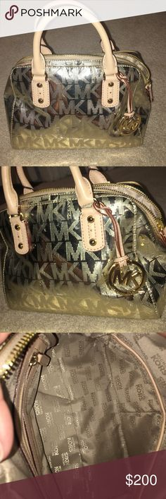 Michael Kors Metallic Gold MK Purse Barely used - brand new condition. Shiny gold with MK logo. Inside has one large pocket on one side, and two medium size pockets on the other side. Michael Kors Bags Satchels