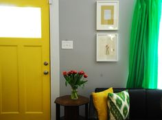 I'm loving the yellow door and green curtains.