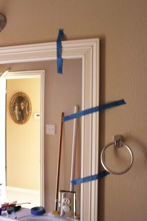 How to DIY a bathroom mirror frame. Need to do this for our bathroom mirror
