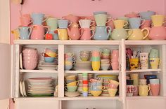 wish I knew who the manufacterer and designer of the pastel dishes was.