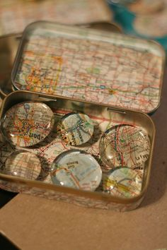 Mini magnets made from clear glass bubbles, pictures, glue together then packaged in papered altoid  tin = cute gift idea