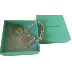 Tiffany & Co. Pre-owned Tiffany & Co. Lancome Elite Paris Charms Chain... ($395) ❤ liked on Polyvore featuring jewelry, bracelets, accessories, none, charm bracelet, bracelet charms, pandora charms, pandora jewelry and star charms