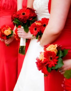 Bridesmaid Bouquets with Red Gerbera Daisies  in Rome GA by Bussey's Florist  https://busseysflorist.com/pages.php?pageid=6