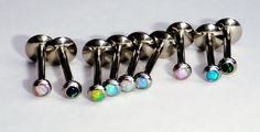 It's opal! It's flat-backed! It's shiny! What more could you want? These little guys looks great in a tragus, labret, hood, or whatever other piercing you want to put one in!   Choose from four iridescent colors: aqua, white, blue, or green. We also have 2 sizes for the post length (8mm or 10mm...