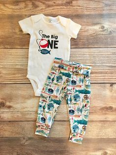 This birthday outfit is perfect for your baby boys party! Both items run true to size. If you would like to switch the outfit to pants, or change the design in any way, please send us a message! Please leave your little fishermens name at checkout
