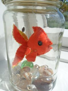 Orange and Yellow Pet Felt Goldfish in a Pickle Jar Aquarium. €8,00, via Etsy.---party favor for undersea party theme