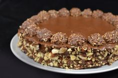 Ferrero Rocher Cake: I'm absolutely addicted to Ferrero Rocher chocolates. Perhaps that was my biggest motivation to create an entire cake recipe, based on Ferrero Rocher chocolates. Torta Ferrero Rocher, Rocher Torte, Ferro Rocher Cake, Sweet Recipes, Cake Recipes, Dessert Recipes, Just Desserts, Delicious Desserts, Delicious Chocolate
