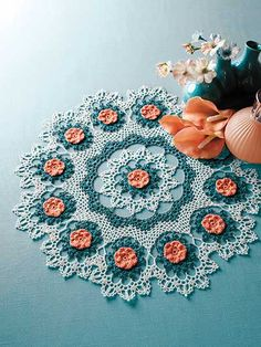 Chantilly Doily Crochet Pattern Download from e-PatternsCentral.com -- The exquisite flower motifs in this prizewinning doily will add a colorful dimension to any room in your home.