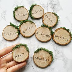 Rustic wood slice and moss wedding place settings / escort cards, perfect for an outdoor woodland or barn wedding. A lovely personalised wooden favour for a rustic theme, these place cards make great keepsakes for your guests to remember your special day. To order, just select your