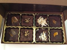 Box of chocolate from Jazz Brownies NYC; from Left to Right, spicy dulce de leche, sesame, black pepper and coconut, and candied (?) orange peel