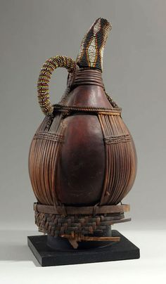 Africa   Palm wine container from the Grassfields region of Cameroon   Gourd, glass beads, thread, cane