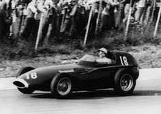 vanwall's stirling moss wins the 1957 italian grand prix