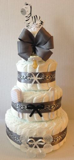 Zebra Diaper Cake. 4 Tier. Please visit us at www.finediapercakes.com for more amazing Diaper Creations. Thank you.