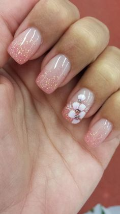 Simple nailart w glitter and flower.very girly