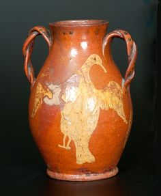 Extremely Rare and Important Redware Vase with Brushed Eagle Decorations and Ornate Twisted Handles