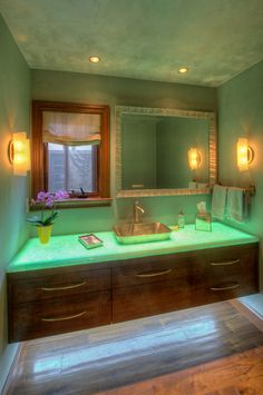 A lighted bathroom countertop beautifully illuminates this bathroom. The under counter light provides plenty of supplement visibility. Remodel by Canyon Construction. Photo by Treve Johnson.