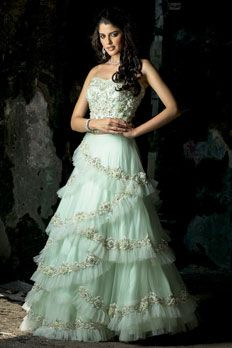 Net frill ghagra with corset blouse, embellished with diamond, sequins and pearl work.