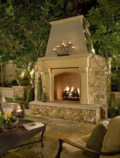 Outdoor stone fireplace and patio. Furniture, outdoor entertaining, outdoor living