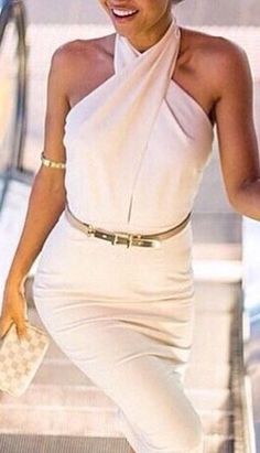 She looks so classy in this white halter neck dress