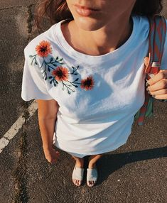 Botanical embroidery unusual womens t-shirt. Hand embroidered tee with an orange flowers on the shoulder. The cute floral embroidery adds some flair and a handcrafted touch to a plain tee. DETAILS: All embroidery is done by hand in 100% french cotton thread. T-shirts are 100% cotton. The