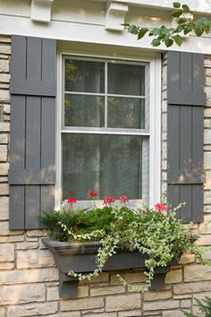 love the shutters and the matching colored flower box