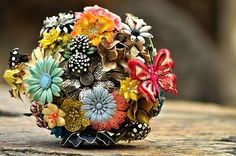 Mixed brooch bouquet with butterfly by Lionsgate Designs.