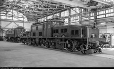 """View into the assembly hall of the Swiss Locomotive and Machine works (SLM) with Gotthard locomotives for freight and passenger trains. In the foreground """"crocodile"""" Be 6/8 III # 13302 from 1926, in the background Be 4/6 #12320 from 1921. The photo doesn't date from the 1920', but from today. The locomotives returned to their birthplace on the occasion of an exhibition for """"750 years Winterthur""""."""