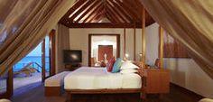 Anantara Resort & Spa Maldives - Sunset-Over-Water-Suite-Bedroom.jpg