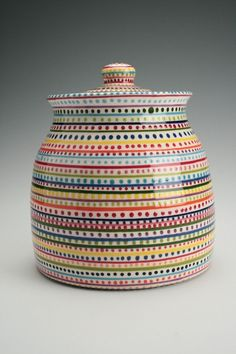 colorful ceramic - i dont like the dots and design but i like the lids and the bowl itself _AMAYA
