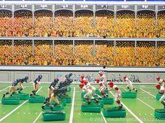 1967 Tudor NFL Electric Football Giants and Browns on a 1961 Gotham NFL G-1500 game.