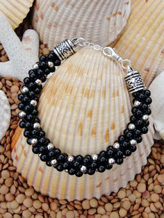 A personal favorite from my Etsy shop https://www.etsy.com/listing/212494351/kumihimo-black-onyx-and-silver-bracelet