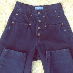 Canyon River Blues Taper Leg High waisted jeans attractive button fly closure.  Buttons easy to close not a tight opening for the buttons. Dark denim color. Canyon River Blues Jeans