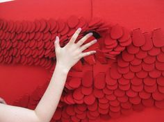 user, and  gives a reward.  'Reveal' is a interactive wall panel made up of felt flaps. The  flaps can be stroked and brushed to uncover the reveal material and the  pattern underneath, creating a sensory experience. The piece showcases  the 'flap and reveal' technique, which can be applied to other surfaces.  'Reveal' adds ambience and warmth to any room and engages the user.  Samantha Grover