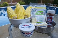 Cheesy Grilled Corn is the best corn I have ever had and it's not even close. Don't boil your corn this 4th of July