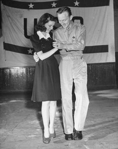 A private and his date dancing at the USO recreation center. 1942